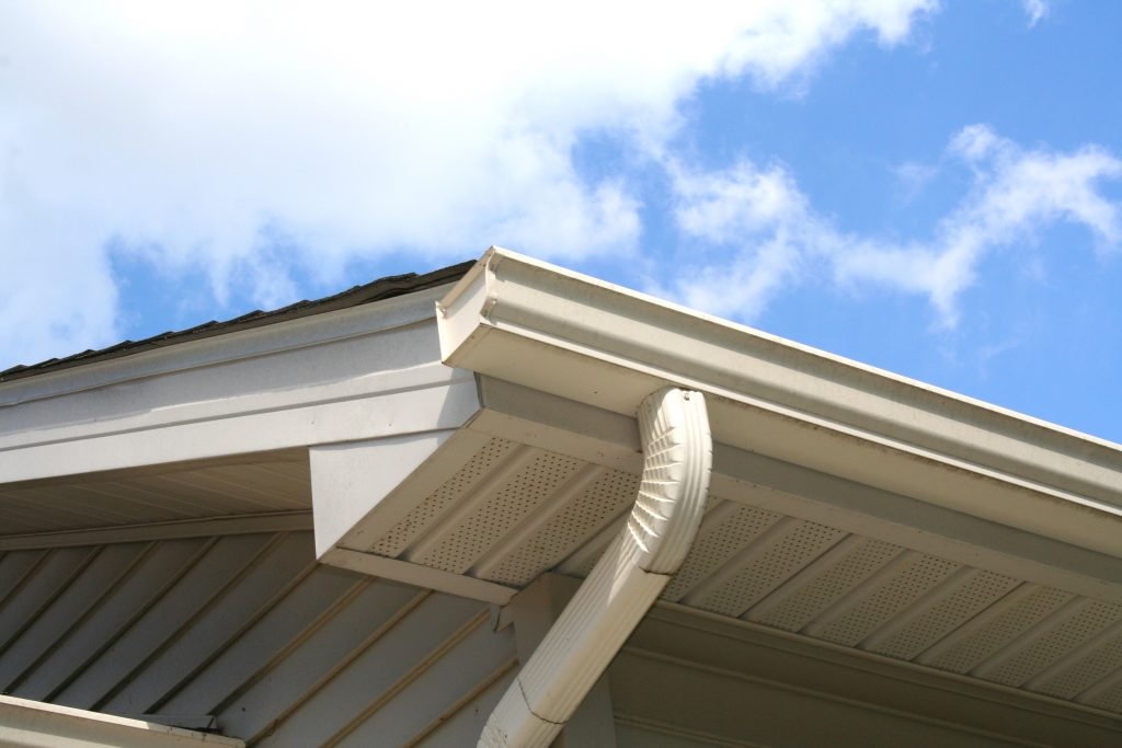 House Gutter and Downspout with Sky